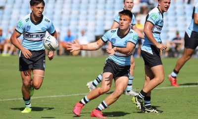 Hooker Kobie Wilson sends the Cronulla Sharks into another attack (Photo : Steve Montgomery)