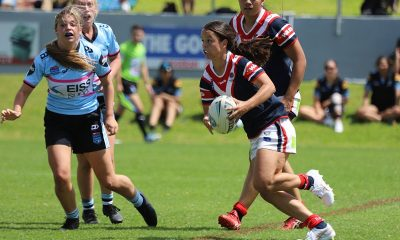 Sydney Indigenous Roosters Tarsha gale Cup halfback Taneka Todhunter tries to find a way through the Sharks line in Rnd 5 at Wyong (Photo : Steve Montgomery)